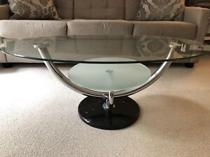 Glass coffee table with black marble base