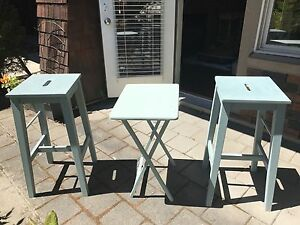 2 bar stools and a side table