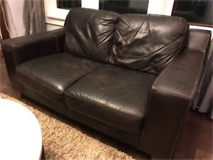 Well loved leather loveseat