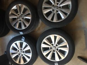 4 - 205/55/R16 tires on alloy rims off of 2015 VW Golf