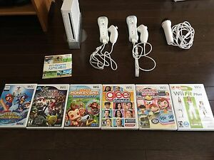 Nintendo Wii + 7 games and & Wii Fit Board