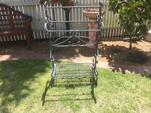 ORNATE METAL STAND HAS BEEN USED OUTSIDE FOR PLANTS LOCATION BENTLEIGH