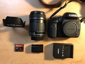 Canon 7D Body, 18-135mm Lens, 16GB CF Card, ew-73B, and battery.