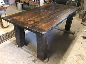 Rustic reclaimed wood harvest dining table and one bench