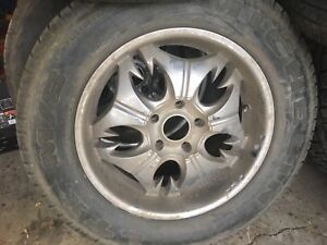 Dodge rims and tires. Already installed. Quick sale!!