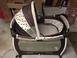 Graco pack and play portable crib and change table