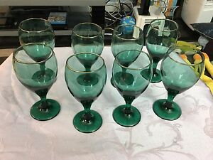 Arby's holiday green with gold rim wine glasses