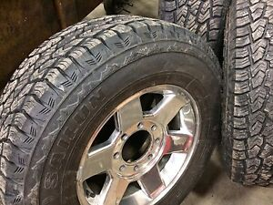 Dodge Ram 3500 factory rims with brand new tires. 17""