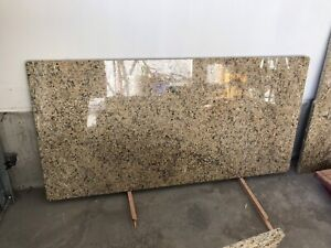 Granite island and two countertop pieces