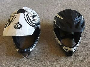 2 BMX or mountain bike helmets both are adult size large