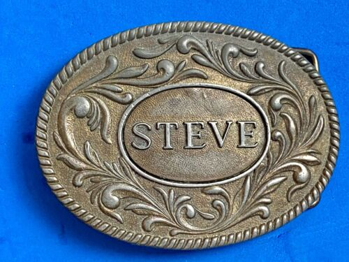 Vintage 1977 western name    STEVE   flower swirl belt buckle by The Kinney Co.