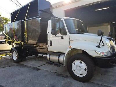 2012 INTERNATIONAL 4300 NEW SWITCH-N-GO LIFT TRUCK WITH BODY 147,883***TMP***