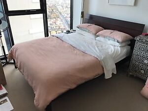 Dark timber bed frame + matching side table Melbourne CBD Melbourne City Preview