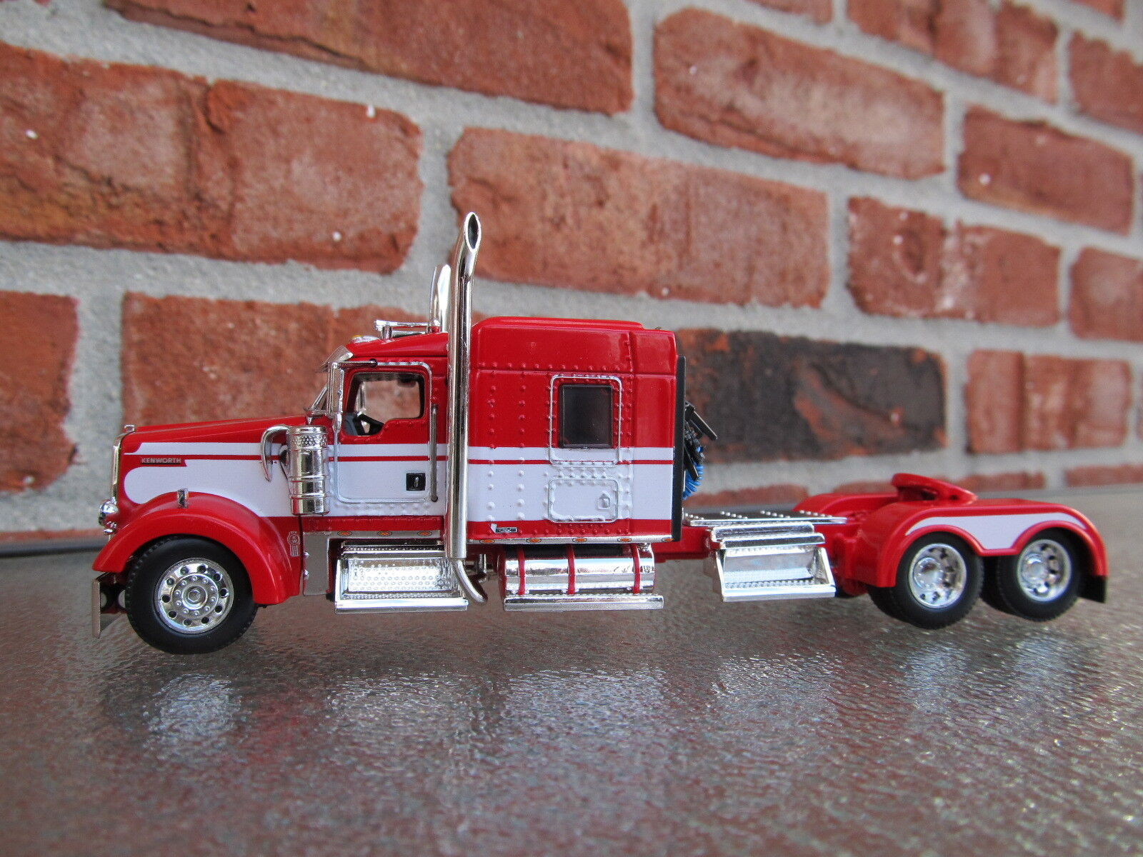DCP 1/64 SCALE W-900 KENWORTH MID ROOF RED/ WHITE SEMINOLE STRIPE TRACTOR ONLY