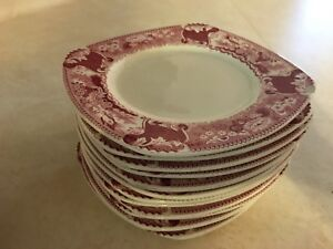 Pink and white plates and saucers