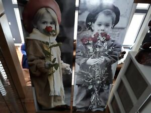 On wood laminated photos of boy and girl