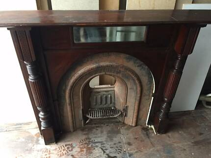 Victorian fireplace with mantle. Cast iron.