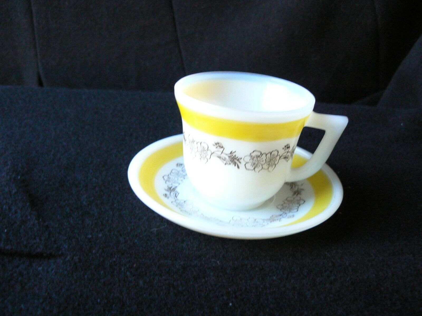 Milk glass with yellow band demitasse cup and saucer with gold apple blossoms