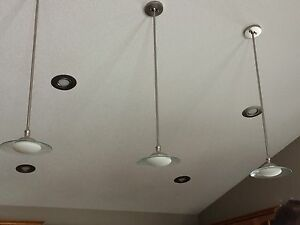 4 bulb chandelier and 3 matching pendant lights