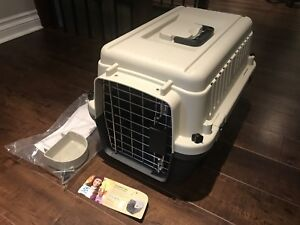 Brand new small plastic dog crate/carrier