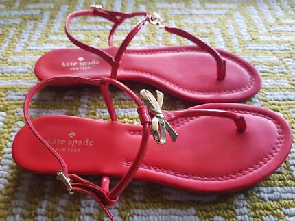 f4d21b8d48d Kate Spade Tracie Gold Metal Bow Maraschino Red Flat Thong Sandal