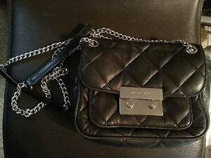 Black quilted Michael Kors purse. Slightly used