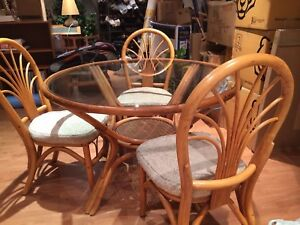Rattan dining table with three chairs
