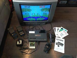 Atari with 10 games and manuals.