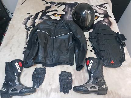 Motorbike helmet, jacket, boots and back protector set.