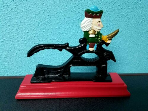 Vintage Christmas Nutcracker Red Wood Base Cast Iron Soldier