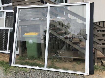 Bradnams glass sliding door 2.4x2.1 & Bradnams white aluminium sliding stacker doors   Building ...