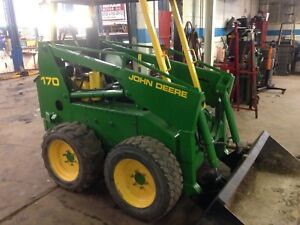 John Deere 170 skid steer with snow plow