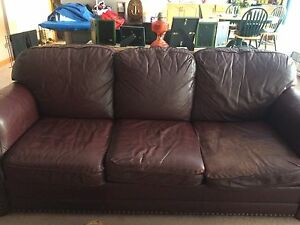 Brownish red leather couch