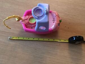Small pink toy boat, makes sounds