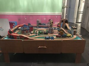 Train table including wooden train tracks & trains - $150