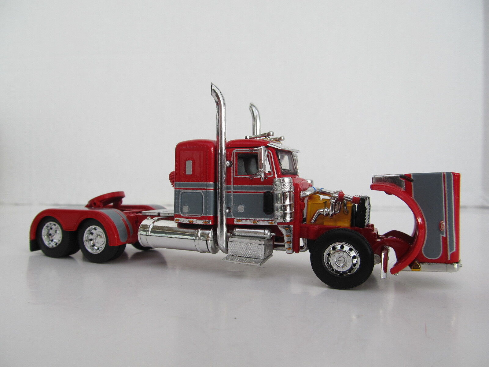 DCP 1/64 SCALE 379 PETERBILT SMALL BUNK (DAY CAB OPT) RED W GRAY SEMINOLE STRIPE 3