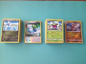 200 Pokemon Cards (Roaring Skies and Sun and Moon)