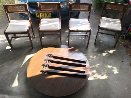 Free - Small round wooden table with chairs