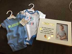 New baby clothes and light up frame