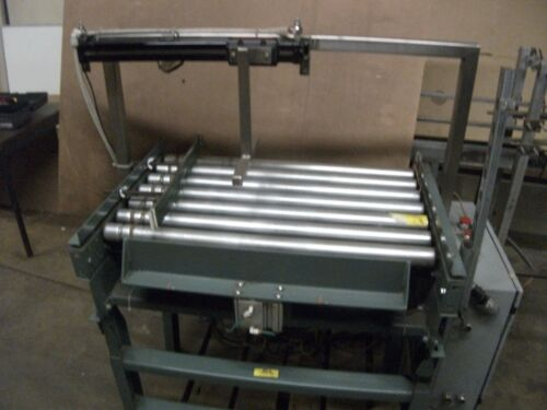 Short Power Roller Conveyor section w/ air cylinders and product stop