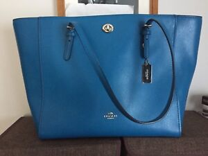 Brand new shape Authentic Coach 2 pc leather set