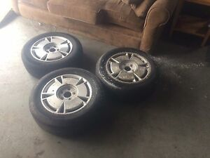 4----15 inch Honda factory rims with centers