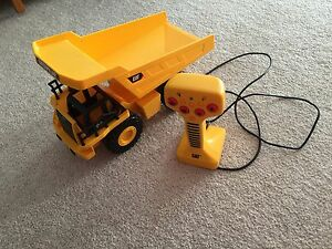 Corded remote controlled CAT dump truck