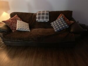 Older dark brown Flax leather couch