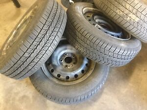Tires like new with steel rims. 5x114.3 205 65 16