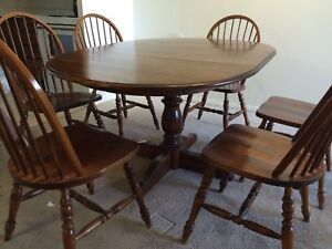 Beautiful wooden dining table with six chairs