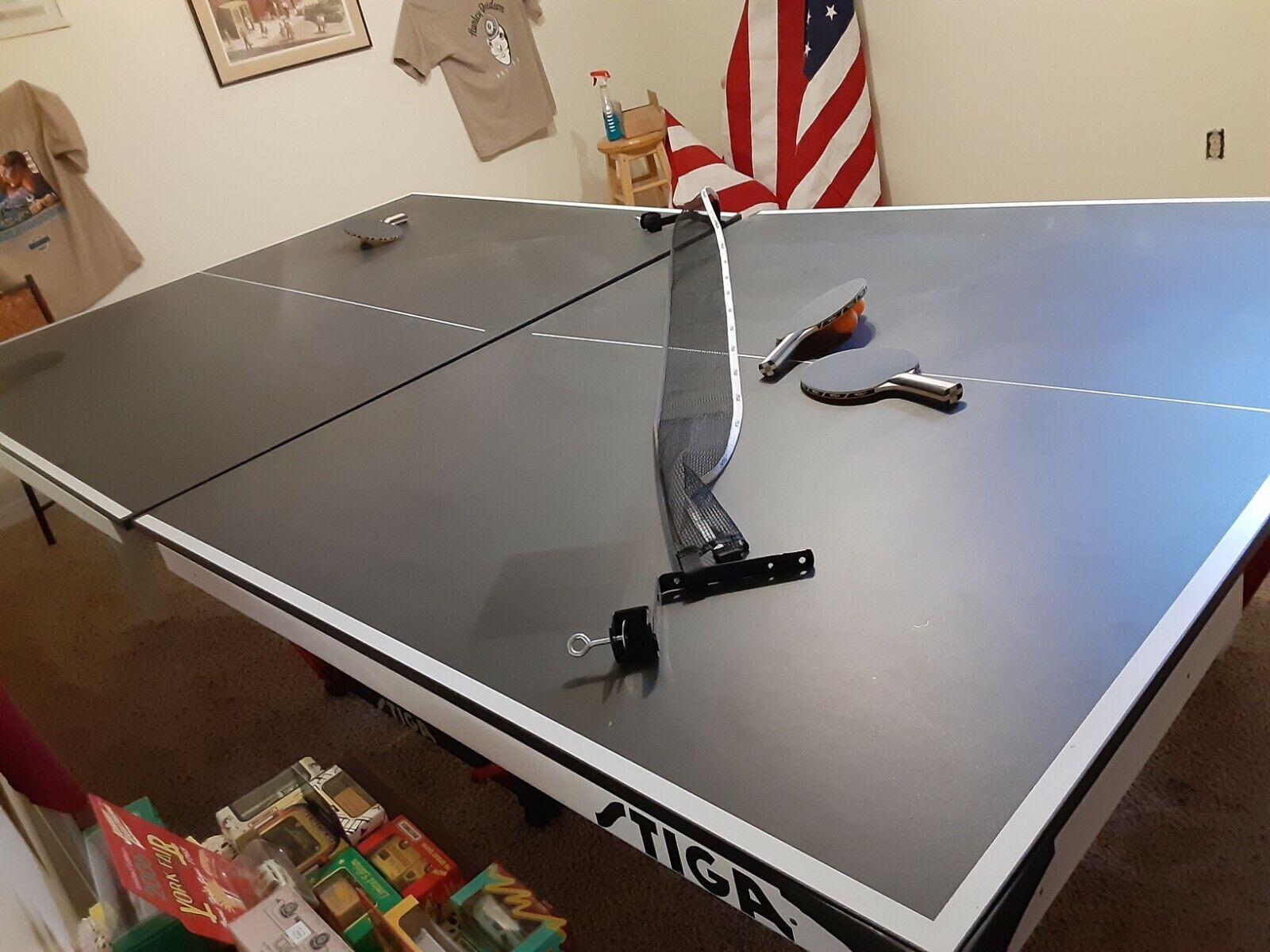 very nice stiga ping pong table with paddles / balls