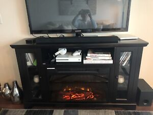 CONDO MOVING SALE: FIREPLACE TV STAND WITH REMOTE