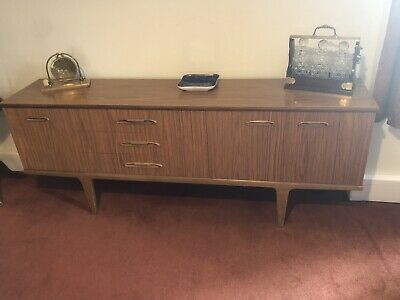 Vintage sideboard cabinet And Table And Chairs from the 1960s.