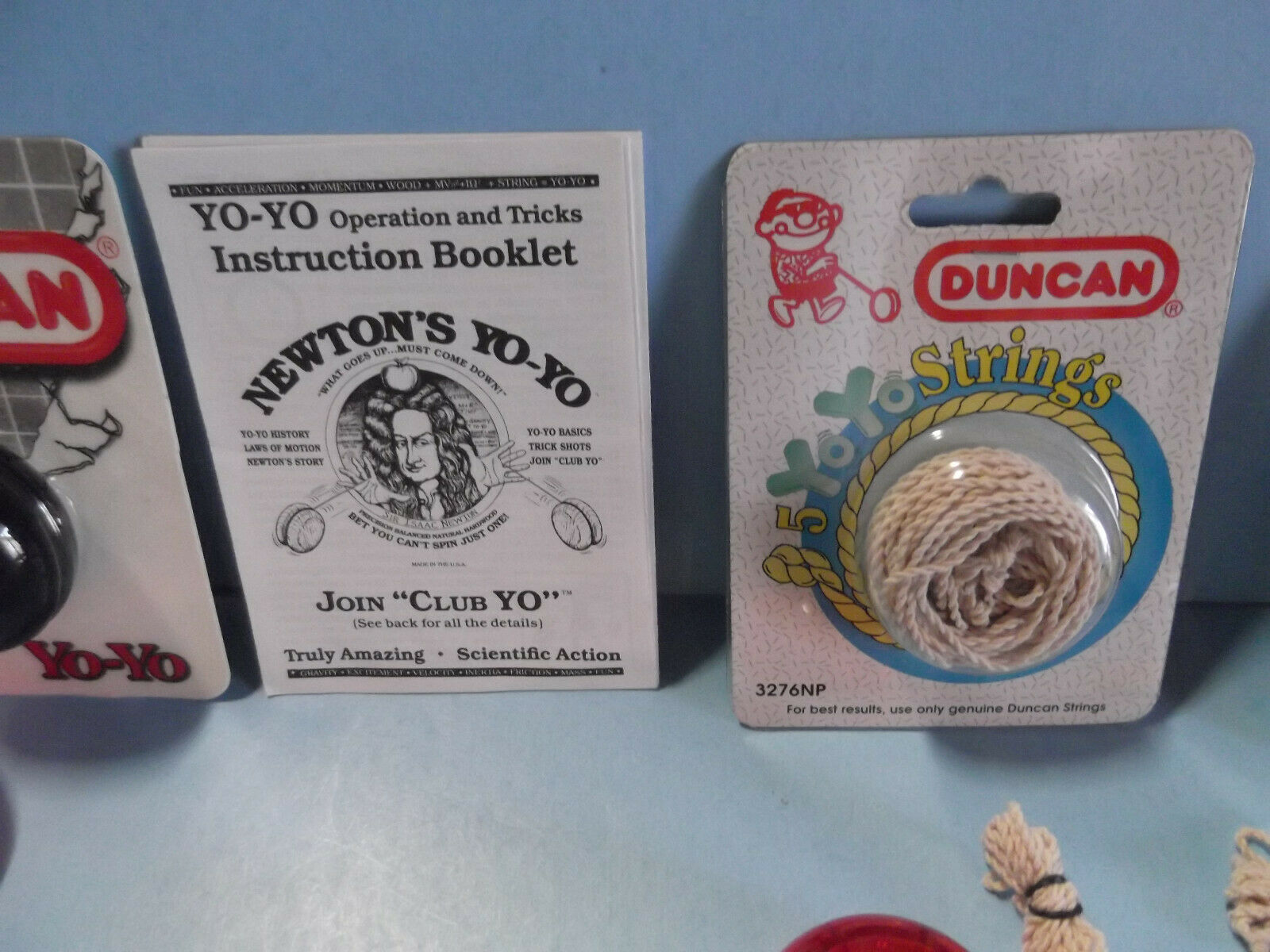 14 Miscellaneous Duncan Wood,Metal and Plastic Yoyo's + Book of Tricks + String